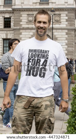 London, United Kingdom - July 4, 2016: Immigrants Protest in Parliament Square in London. A peaceful protest was held in Parliament Square to emphasise how much Britain gains from its migrants.