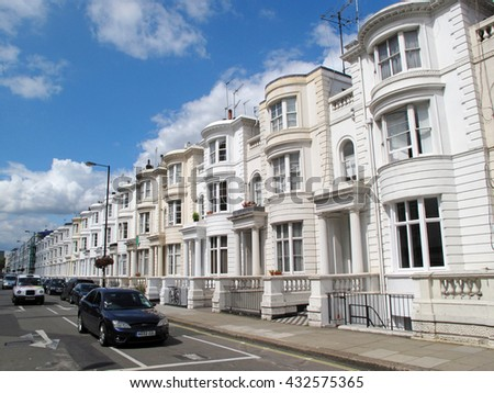 LONDON, UNITED KINGDOM - JULY 19, 2012: Luxury residential properties on Eaton Place, Belgravia in central London, U.K. It is the most expensive neighborhoods of central London. - stock photo