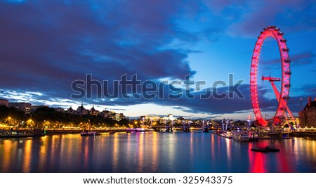 LONDON, UNITED KINGDOM - JULY 28, 2015: The London Eye on the edge of the Thames River provides a great vantage point over central London - stock photo