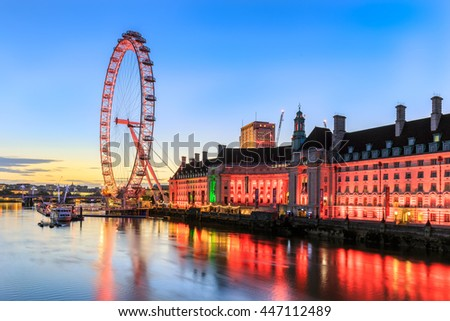 LONDON, UNITED KINGDOM - JULY 03, 2016. The London Eye on the South Bank of the River Thames at night. This is the tallest Ferris wheel in Europe at 135 meters.  - stock photo