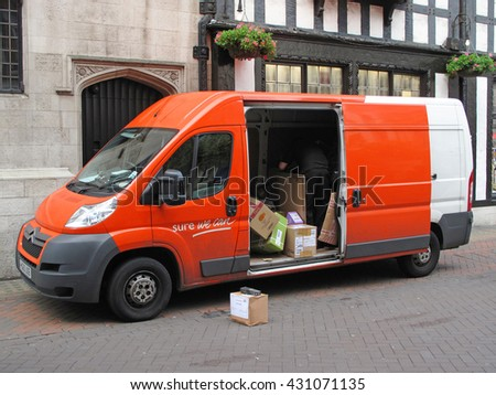LONDON, UNITED KINGDOM - JULY 19, 2012: TNT Express delivery van delivering package to customer in London. TNT is an international courier delivery services company with headquarters in Netherlands.