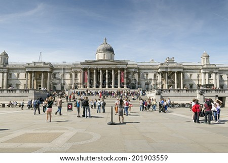 LONDON, UNITED KINGDOM - JUNE 6, 2014 : A lot of tourists and young people gathering to meet each other in front of the National Gallery in Trafalgar Square