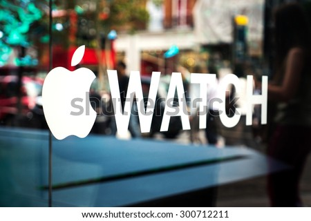 LONDON, UNITED KINGDOM - JUNE 21, 2015: Apple watch sign printed on window store. Apple Watch is a smartwatch developed by Apple Inc, integrated with iOS and other Apple products and services. - stock photo