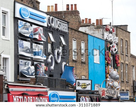 LONDON, UNITED KINGDOM - JUNE 17, 2015: Camden Town Market, famous alternative culture shops in Camden Town, London, England. Camden Town markets are visited by 100,000 people each weekend. - stock photo