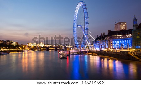 LONDON, UNITED KINGDOM - JUNE 25: London Eye on June 25, 2013 in London, United Kingdom is the tallest Ferris wheel in Europe at 135 meters - stock photo