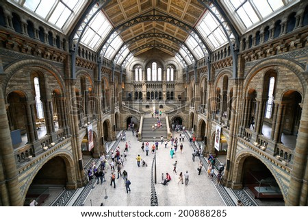 LONDON, UNITED KINGDOM - JUNE 22; Natural History Museum interior in London, United Kingdom - June 22, 2014; Famous London Natural History Museum big hall interior with tourists visitors - stock photo