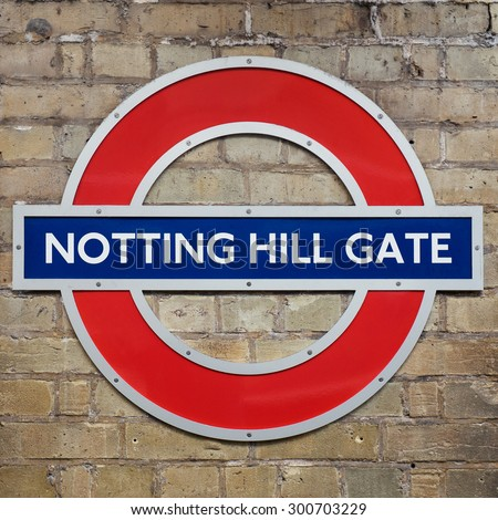 LONDON, UNITED KINGDOM - JUNE 21, 2015: Notting Hill Gate Station sign. The Underground system serves 270 stations and has 402 kilometres (250 mi) of track, 45 per cent of which is underground. - stock photo