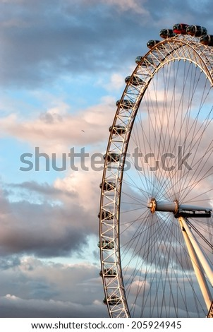 LONDON, UNITED KINGDOM - MARCH 24: London Eye on March 24, 2014 in London. The London Eye is a giant Ferris wheel on the South Bank of the River Thames in London, also known as the Millennium Wheel. - stock photo