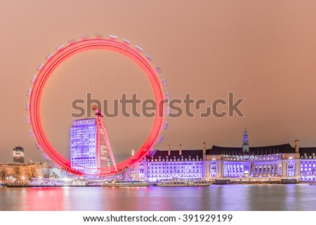 London, United Kingdom - March 3, 2016: Thames river at night with the London Eye, panoramic view of London at night. - stock photo