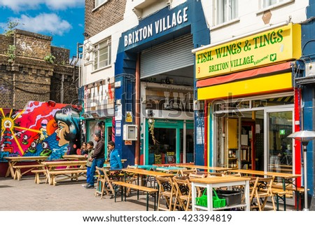 London, United Kingdom - May 14, 2016: Brixton Village and Brixton Station Road Market. Colorful and multicultural community market run by local traders in South London. - stock photo