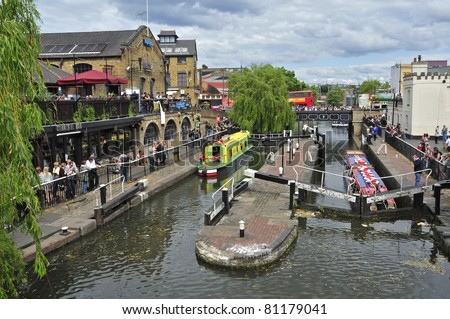 LONDON, UNITED KINGDOM - MAY 8: Camden Lock on May 8, 2011 in London, United Kingdom. Camden Lock, or Hampstead Road Locks, is the only twin-lock remaining on the Regent's Canal in Camden Town - stock photo