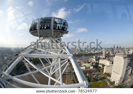 LONDON, UNITED KINGDOM - MAY 31: Detail of London Eye's cabins on May 31, 2011 in London, UK. London Eye is the tallest Ferris wheel in Europe at 135 meters. - stock photo