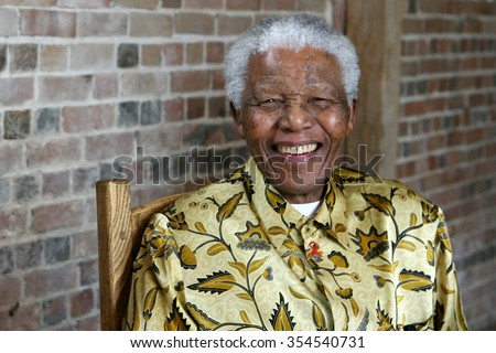LONDON, UNITED KINGDOM- 24 MAY 2006: Late South African president Nelson Mandela smiles as he poses for a portrait in London.  - stock photo