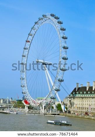 LONDON, UNITED KINGDOM - MAY 6: London Eye on May 6, 2011 in London, UK. London Eye is the tallest Ferris wheel in Europe at 135 meters. - stock photo
