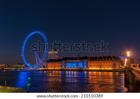 LONDON, UNITED KINGDOM - May 10: Night view of the South Bank of the River Thames including the world famous landmark, London Eye on May 10, 2011 in London. - stock photo