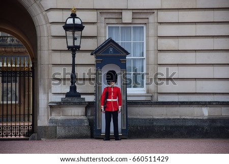 LONDON, UNITED KINGDOM - MAY 7 2017: The queen guard stand in front of Buckingham palace, LONDON