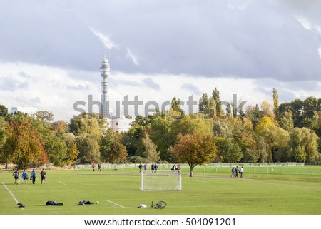 London, United KIngdom - October 16, 2016: Autumn on a Sunday in London. The BT tower is a landmark easily seen from Regent's Park, a public area where the locals gather to play community sport.