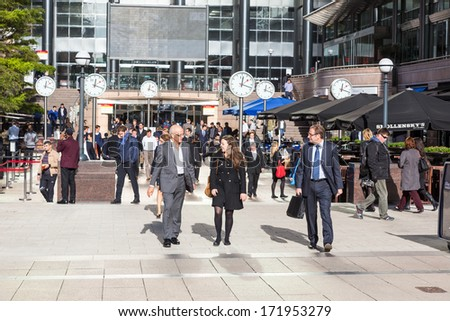 LONDON, UNITED KINGDOM - OCTOBER 30, 2013: Commuters in Canary Wharf, the Financial District of the city - stock photo