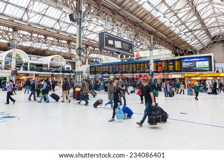 LONDON, UNITED KINGDOM - OCTOBER 25, 2013: Crowded Victoria Station during Rush Hour. - stock photo