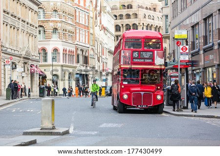 LONDON, UNITED KINGDOM - OCTOBER 24, 2013: Famous red Double-Decker at Monument bus stop - stock photo