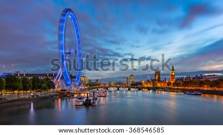 LONDON, UNITED KINGDOM - OCTOBER 6, 2014: London Eye and Westminster Palace in London. The largest Ferris Wheel in Europe, structure of the London Eye is 135 meters tall and 120 meters in diameter. - stock photo