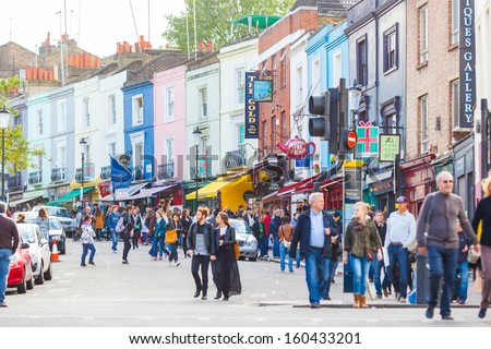LONDON, UNITED KINGDOM - OCTOBER 27: People in Portobello Road, a famous market area in Notthing Hill district on October 27, 2013 in London, United Kingdom. - stock photo