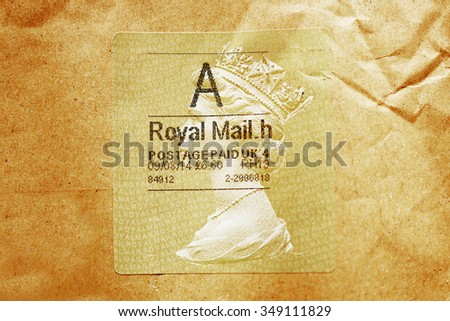 LONDON, UNITED KINGDOM - OCTOBER 18, 2015: Royal Mail postage stamp with Portrait of Queen Elizabeth with mark Postage paid - stock photo