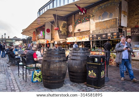 LONDON, UNITED KINGDOM - OCTOBER 10, 2014:  Street view of outdoor dining along the Camden Market in London. - stock photo
