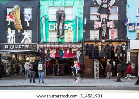 LONDON, UNITED KINGDOM - OCTOBER 10, 2014:  Street view of shops and shoppers along the Camden Market in London. - stock photo
