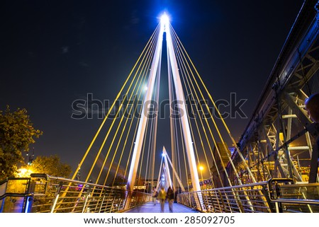 LONDON, UNITED KINGDOM - OCTOBER 8, 2014:  :View of The Golden Jubilee Bridge in London England seen at night - stock photo