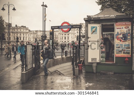 LONDON, UNITED KINGDOM - OCTOBER 7, 2014:  Vintage filter effect image of street in London with entrance to Underground - stock photo