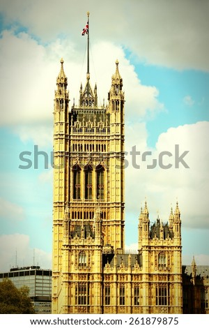 London, United Kingdom - Palace of Westminster. Cross processed vintage photo filtered tone. - stock photo
