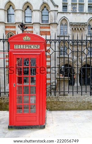 London, United Kingdom - red telephone booth typical for England. - stock photo