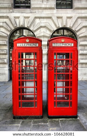 London, United Kingdom - red telephone booths. Phone boxes. - stock photo