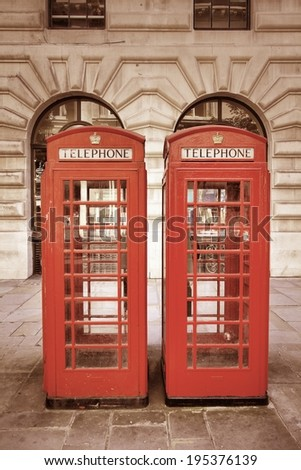 London, United Kingdom - red telephone booths. Phone boxes. Cross processing color tone - filtered retro style. - stock photo
