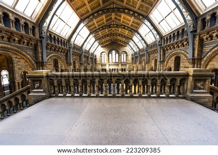 LONDON, UNITED KINGDOM - September 23; Natural History Museum interior in London, United Kingdom - September 23, 2014; Famous London Natural History Museum big hall interior with tourists visitors - stock photo