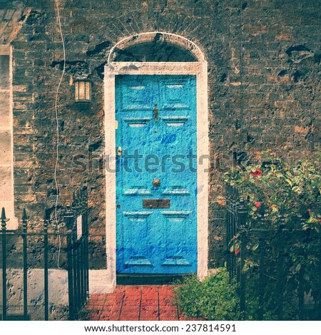 London, United Kingdom - typical colorful Victorian architecture door. Square composition. Cross processed retro style color tone. - stock photo