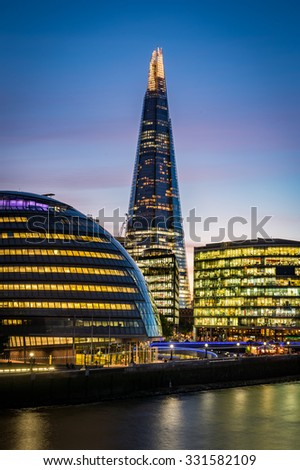 LONDON, UNITED KINGDOM (UK) - SEPTEMBER 28, 2015: Night photo of The Shard on September 28, 2015 in London. It is the tallest building in European Union, designed by the Italian architect Renzo Piano. - stock photo