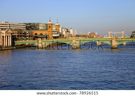London view, river thames with some old and new buildings - stock photo