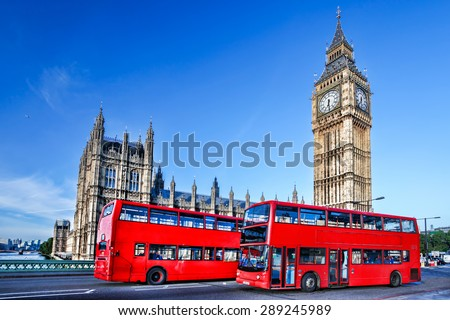 London with red bus against Big Ben in England, UK