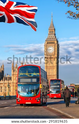 London with red buses against Big Ben in England, UK - stock photo
