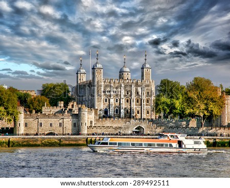 London with Tower Hill old castle against boat in  England, UK - stock photo