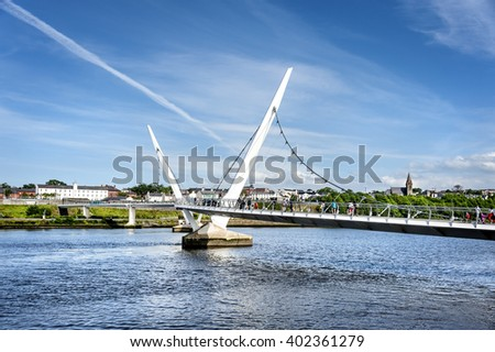 Londonderry, Northern Ireland - June 23, 2015: Peace Bridge and Foyle river. The footbridge connetcs Ebrington Square with the city center.
