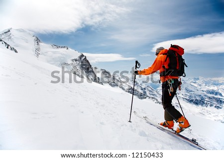 Lone Alpine Touring Skier on the big Verra Glacier; in background the peaks of Castore and Polluce. MonteRosa, Swiss-Italy border. - stock photo