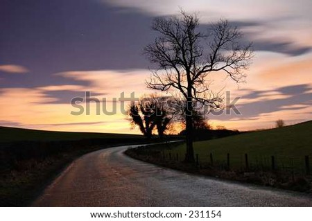 Lone and Winding Road - stock photo