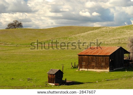 Lone barn and shed on a California hillside - stock photo