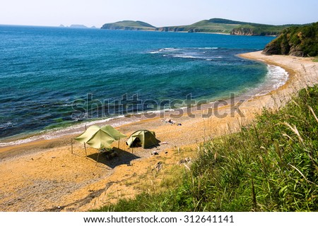 lone camping on desert beach on the russian isle Putyatin  - stock photo