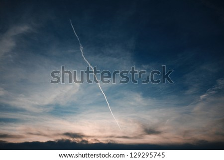 Lone chem trail in the last lights of the sunset