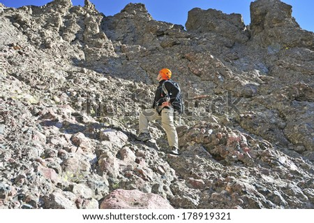 Lone Climber in the Mountains, Rocky Mountains, Colorado - stock photo