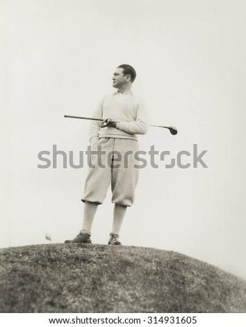 Lone golfer - stock photo